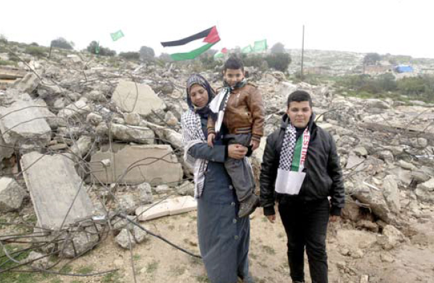 Hebron: Masalmah Family in Front of their House Demolished by Israeli Forces in Tarousa Village