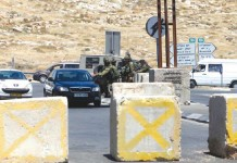 Jerusalem – Israeli Forces Establish Checkpoints at Entrances to Hezma Village. Photo taken by Mahmoud Elayan